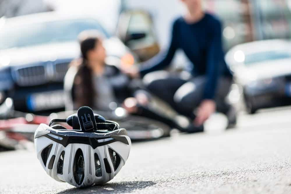 Close-up of bicycle helmet on ground