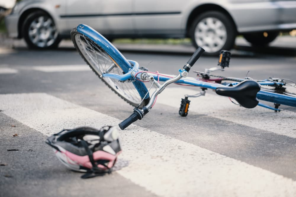 Bike and helmet on road by car following accident